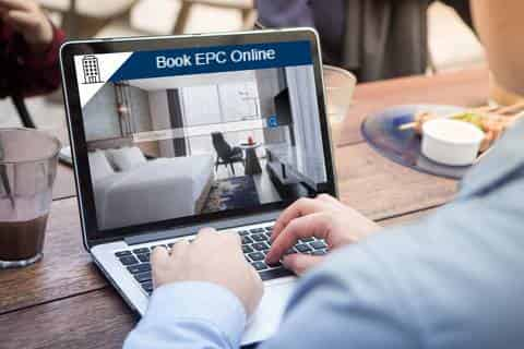 Man at laptop booking an epc online
